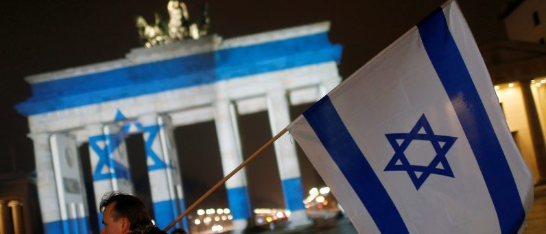 The Brandenburg Gate in Berlin, Germany, is illuminated with the colours of the Israeli flag to show solidarity with the victims of the recent truck attack in Israel