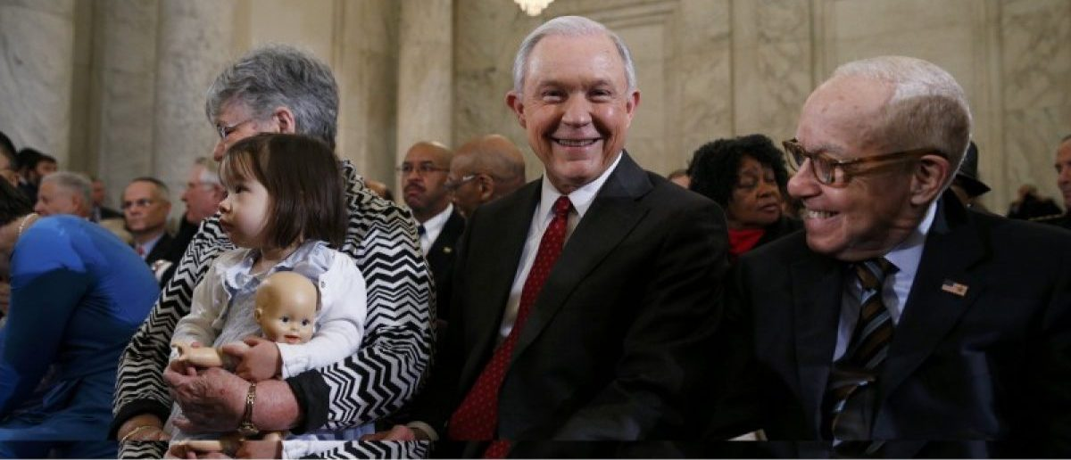 U.S. Sen. Jeff Sessions (R-AL) sits with former U.S. Attorney General Michael Mukasey (R) and Sessions