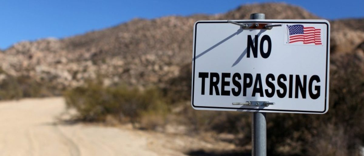 A sign stands on a private property near the U.S.-Mexico border fence near Jacumba, California, U.S., November 14, 2016. REUTERS/Mike Blake