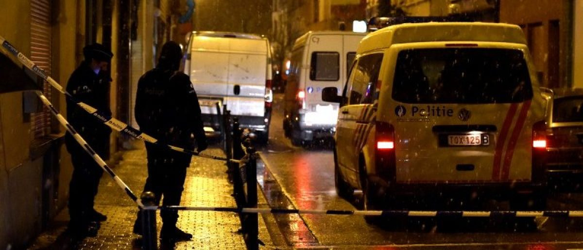 Belgian police officers stand guard at the scene of a security operation in the Brussels district of Molenbeek, Belgium, January 14, 2017. REUTERS/Eric Vidal
