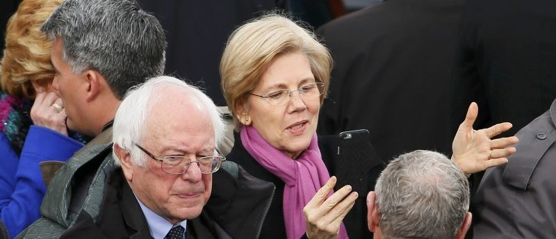 Democratic Senators Bernie Sanders and Elizabeth Warren speak at the inauguration ceremonies swearing in Donald Trump as the 45th president of the United States on the West front of the U.S. Capitol in Washington, U.S., January 20, 2017. REUTERS/Rick Wilking