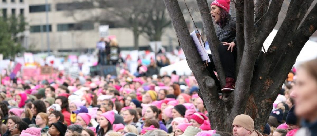 People listen to speeches at the Women's March. REUTERS/Canice Leung