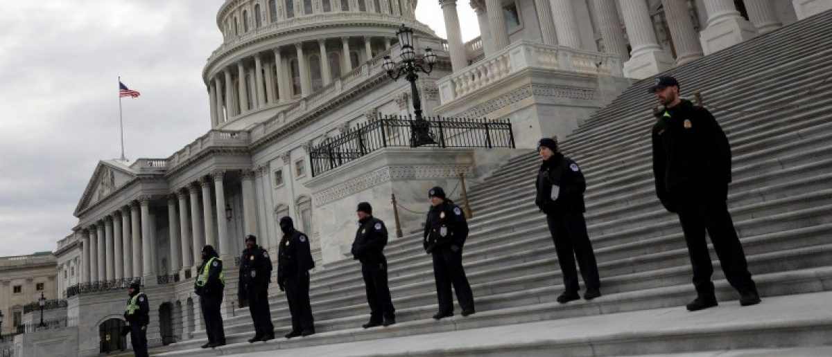 Capitol Hill Police officers look on as activists gather at the US Capitol to protest President Donald Trump's executive actions on immigration in Washington January 29, 2017.  REUTERS/Aaron P. Bernstein