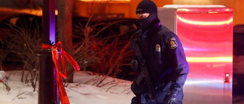 A police officer patrols the perimeter near a mosque after a shooting in Quebec City. REUTERS/Mathieu Belanger