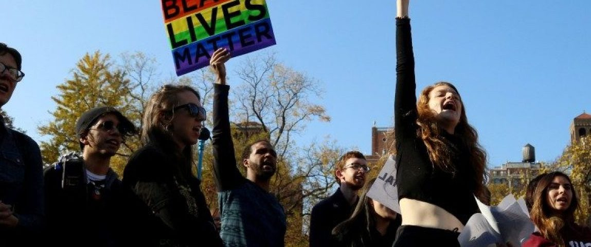 Students of New York University (NYU) hold signs during a demonstration joining with other colleges across the nation participating in #SanctuaryCampus, a protest against President-elect Donald Trump in Manhattan, New York, U.S. on November 16, 2016. REUTERS/Bria Webb/File Photo