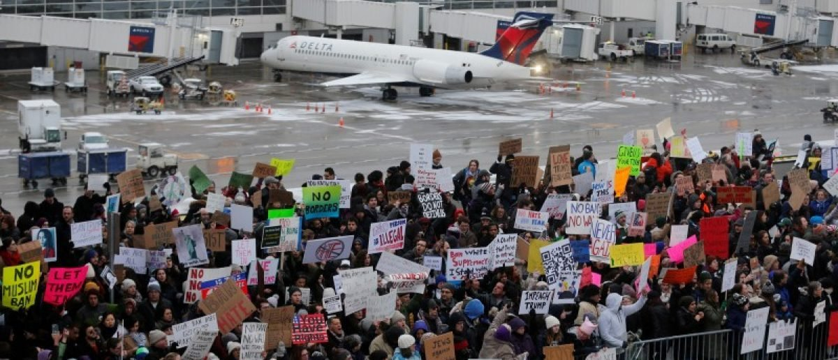 Hundreds of people rally against a travel ban signed by President Trump in an executive order, during a protest at Detroit Metropolitan airport in Romulus, Michigan. REUTERS/Rebecca Cook