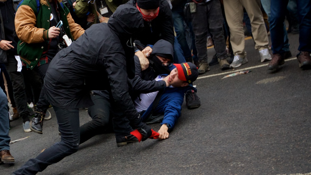 A protester chokes a Trump supporter as they attempt to steal his – Daily Caller – Grae Stafford