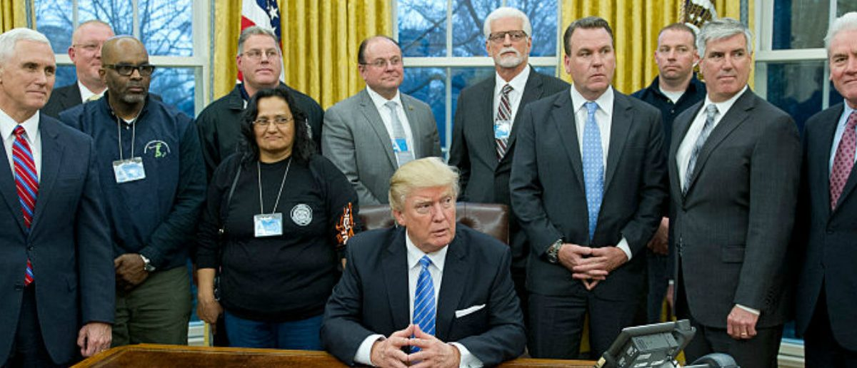 WASHINGTON, DC - JANUARY 23: (AFP-OUT) President Donald Trump poses for a group photo at a meeting with union leaders at the White House on January 23, 2017 in Washington, DC. President Trump held a listening session with business leaders earlier in the day. (Photo by Ron Sachs-Pool/Getty Images)