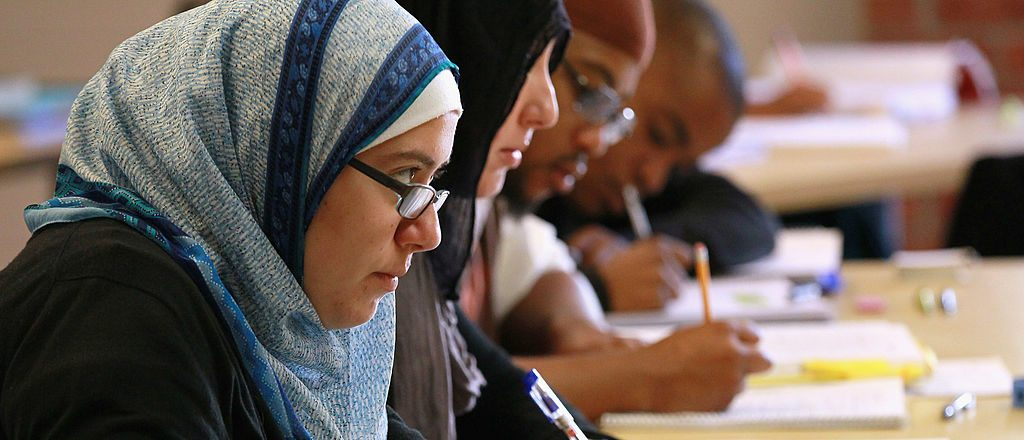 BERKELEY, CA - AUGUST 30: Leenah Safi (L) looks on during a lecture at Zaytuna College August 30, 2010 in Berkeley, California. Zaytuna College opened its doors on August 24th and hopes to become the first accredited four-year Islamic college in the United States. The school was founded by three Muslim-American scolars and offers degrees in Islamic law, theology and Arabic languages. Fifteen students are enrolled in the inaugural class and the school hopes to increase that number to 2,200 within ten years. (Photo by Justin Sullivan/Getty Images)