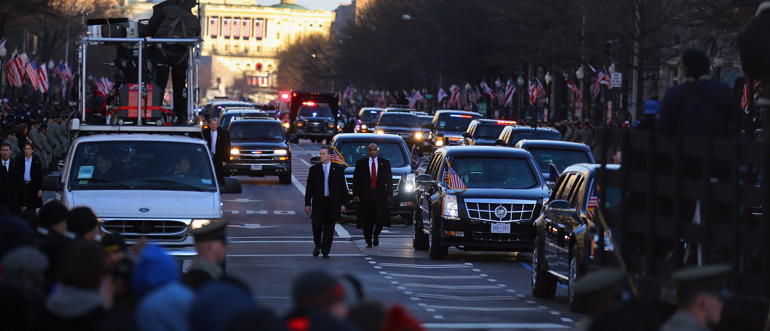 WASHINGTON, DC - JANUARY 21: U.S. President Barack Obama drives down Pennsylvania avenue in his vehicle during the Inauguration Parade on January 21, 2013 in Washington, DC. The President was sworn in for second term. (Photo by Joe Raedle/Getty Images)