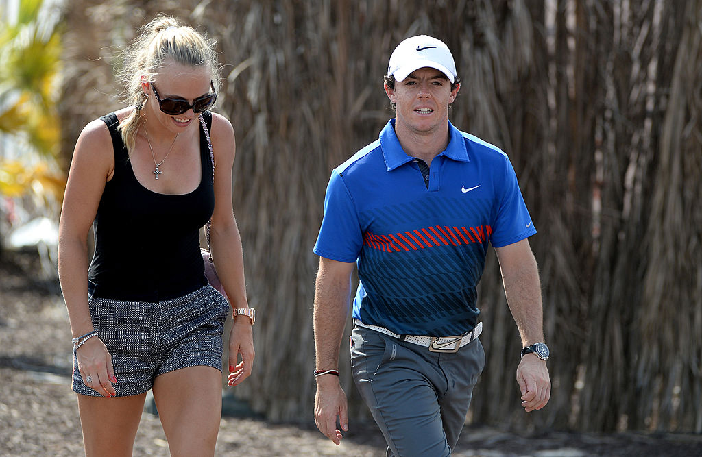 Tennis star, Caroline Wozniacki of Denmark and Rory McIlroy of Northern Ireland after the first round of the DP World Tour Championship, on the Earth Course at the Jumeirah Golf Estates on November 14, 2013 in Dubai, United Arab Emirates. (Photo by Ross Kinnaird/Getty Images)