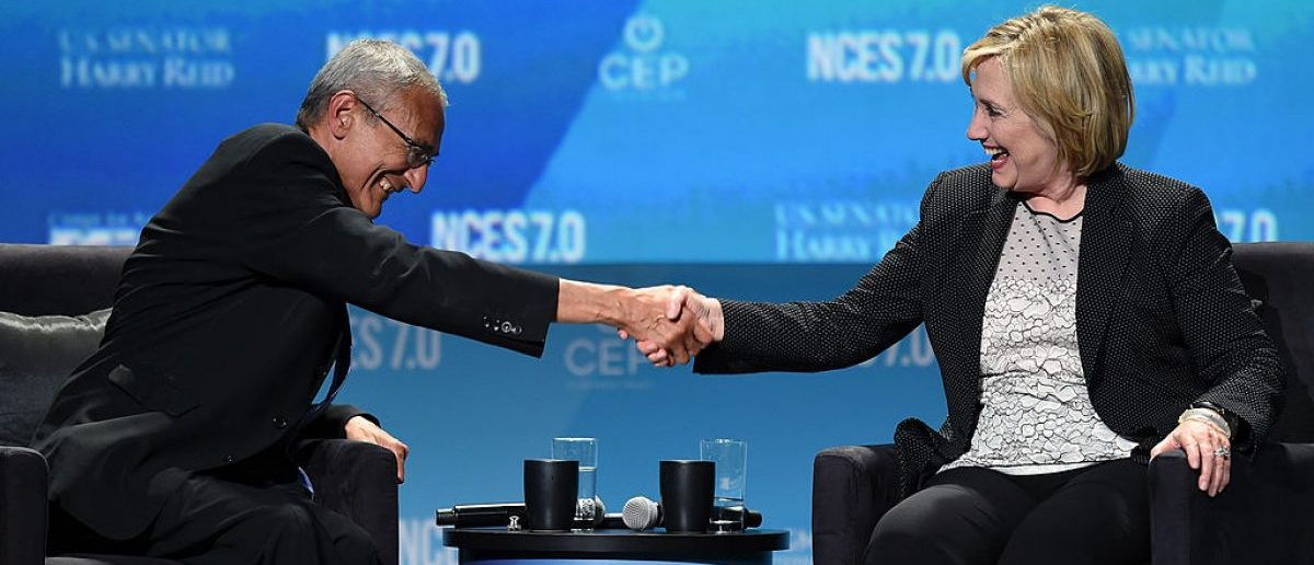 LAS VEGAS, NV - SEPTEMBER 04: Counselor to President Barack Obama, John Podesta (L) and former Secretary of State Hillary Clinton attend the National Clean Energy Summit 7.0 at the Mandalay Bay Convention Center. (Photo by Ethan Miller/Getty Images)