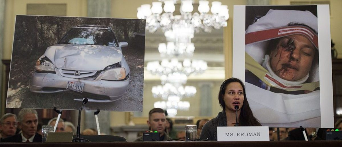 Air Force Lt. Stephanie Erdman, whose eye was injured by airbag shrapnel from her 2002 Honda Civic, is surrounded by pictures showing the accident as she testifies before the US Senate Committee on Commerce, Science, and Transportation on Capitol Hill in Washington, DC, November 20, 2014, on the Takata airbag defects and the vehicle recall process.              (Photo credit: JIM WATSON/AFP/Getty Images)