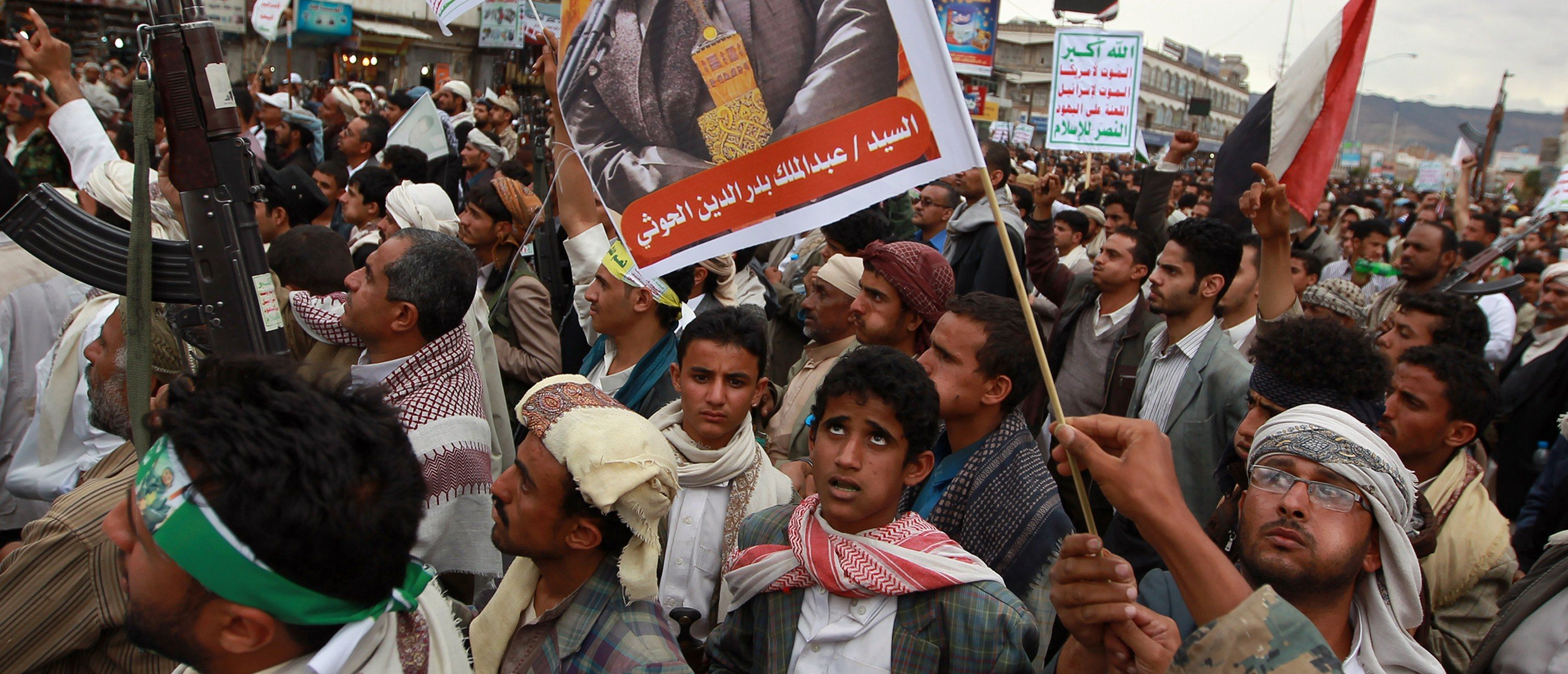 """Yemeni supporters of the Shiite Huthi militia hold a portrait the movement's leader, Abdul-Malik al-Huthi, on March 26, 2015, during a gathering in Sanaa to show support the militia and against the Saudi-led intervention in the country. Warplanes from a Saudi-led Arab coalition bombed Huthi rebels in support of Yemen's embattled president, as regional rival Iran warned the intervention was a """"dangerous"""" move. MOHAMMED HUWAIS/AFP/Getty Images"""