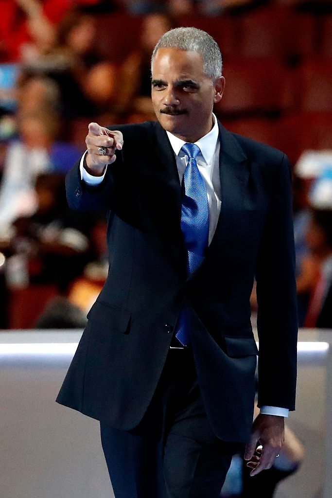 Eric Holder points to the crowd on the second day of the Democratic National Convention at the Wells Fargo Center onJuly 26, 2016 in Philadelphia, Pennsylvania (Getty Images)