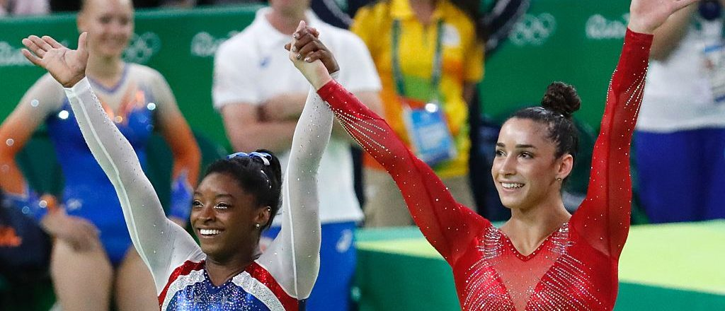 US gymnast Simone Biles (L) and  her compatiot Alexandra Raisman celebrate after the women's individual all-around final of the Artistic Gymnastics at the Olympic Arena during the Rio 2016 Olympic Games in Rio de Janeiro on August 11, 2016. US gymnast Simone Biles won the event ahead of her compatiot Alexandra Raisman and Russia's Aliya Mustafina. / AFP / Thomas COEX        (Photo credit: THOMAS COEX/AFP/Getty Images)