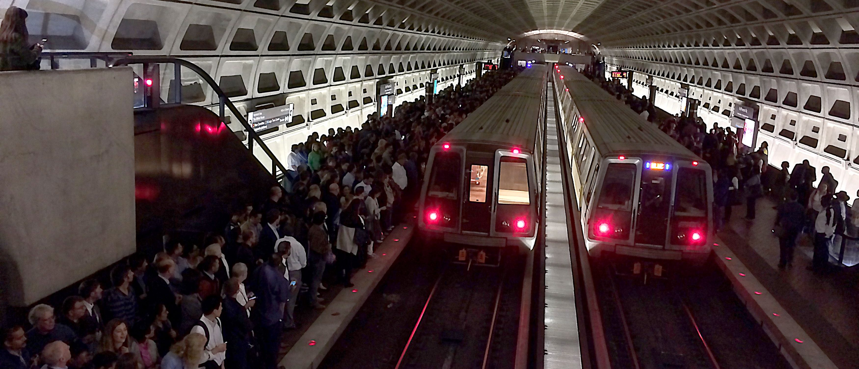 This October 11, 2016 photo shows hundreds of riders on the platform after system problems caused backups at the McPherson Square Metro stop in Washington, DC. KAREN BLEIER/AFP/Getty Images
