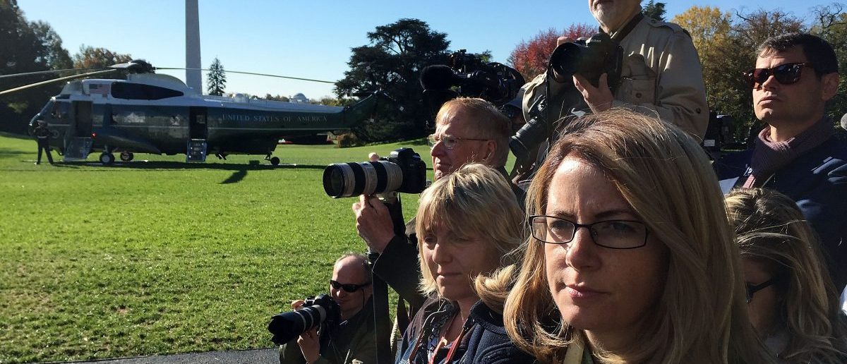 WASHINGTON, DC - NOVEMBER 07: Members of the White House press corps wait for U.S. President Barack Obama to come out from the residence prior to his departure from the White House November 7, 2016 in Washington, DC. President Obama is travelling to the battleground states of Michigan, New Hampshire and Pennsylvania to campaign for Democratic presidential nominee Sec. Hillary Clinton. (Photo by Alex Wong/Getty Images)