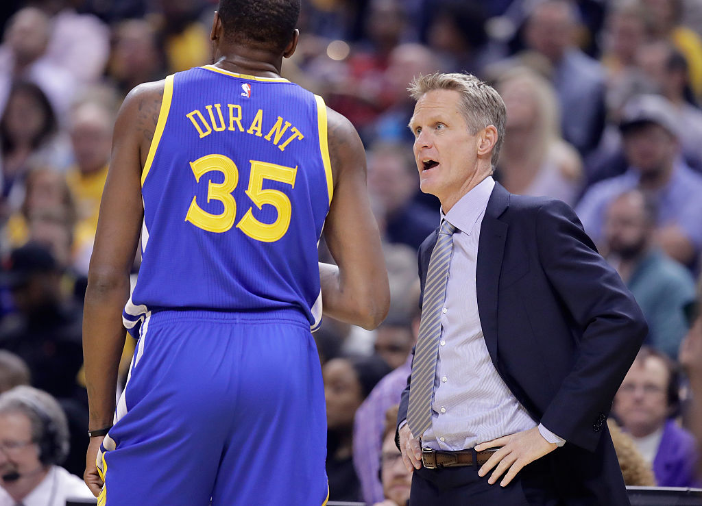 Steve Kerr the head coach of the Golden State Warriors talks with Kevin Durant #35 during the game against the Indiana Pacers at Bankers Life Fieldhouse on November 21, 2016 in Indianapolis, Indiana. NOTE TO USER: User expressly acknowledges and agrees that, by downloading and or using this photograph, User is consenting to the terms and conditions of the Getty Images License Agreement (Photo by Andy Lyons/Getty Images)