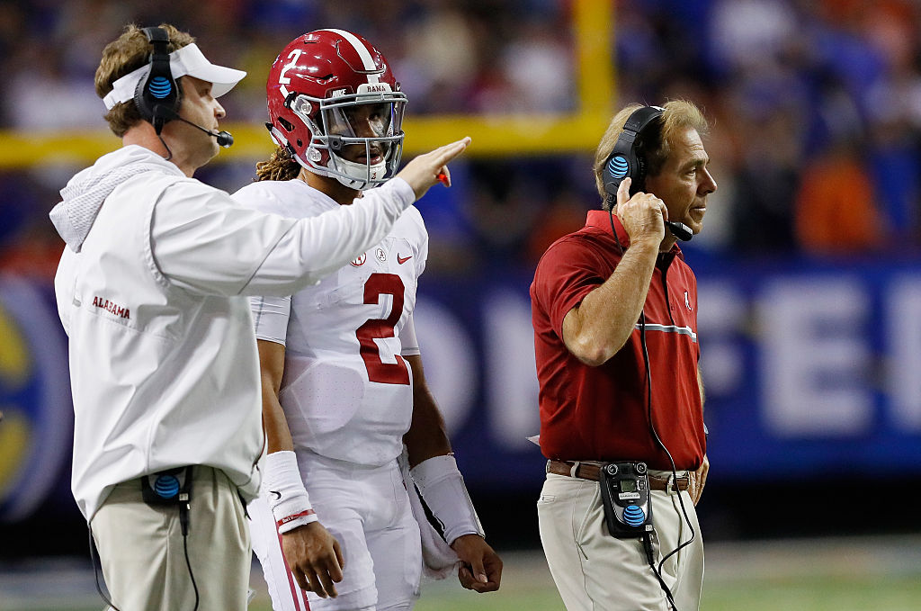 Head coach Nick Saban, and Offensive Coordinator Quarterbacks Lane Kiffin talk to Jalen Hurts #2 of the Alabama Crimson Tide in the second half against the Florida Gators during the SEC Championship game at the Georgia Dome on December 3, 2016 in Atlanta, Georgia. (Photo by Kevin C. Cox/Getty Images)