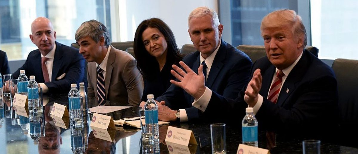 (L-R) Amazon's chief Jeff Bezos, Larry Page of Alphabet, Facebook COO Sheryl Sandberg , Vice President Mike Pence and President Donald Trump attend a meeting at Trump Tower December 14, 2016 in New York. (Photo credit: TIMOTHY A. CLARY/AFP/Getty Images)