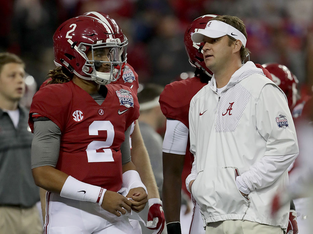 Jalen Hurts #2 of the Alabama Crimson Tide and Offensive Coordinator Lane Kiffin of the Alabama Crimson Tide talk during pre gamethe 2016 Chick-fil-A Peach Bowl at the Georgia Dome on December 31, 2016 in Atlanta, Georgia. (Photo by Streeter Lecka/Getty Images)