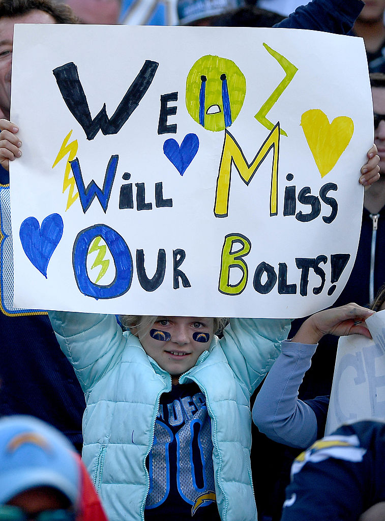 A fan of the San Diego Chargers holds a sign en route to the Charger's 37-27 loss to the Kansas City Chiefs during their NFL game at Qualcomm Stadium on January 1, 2017 in San Diego, California. (Photo by Donald Miralle/Getty Images)
