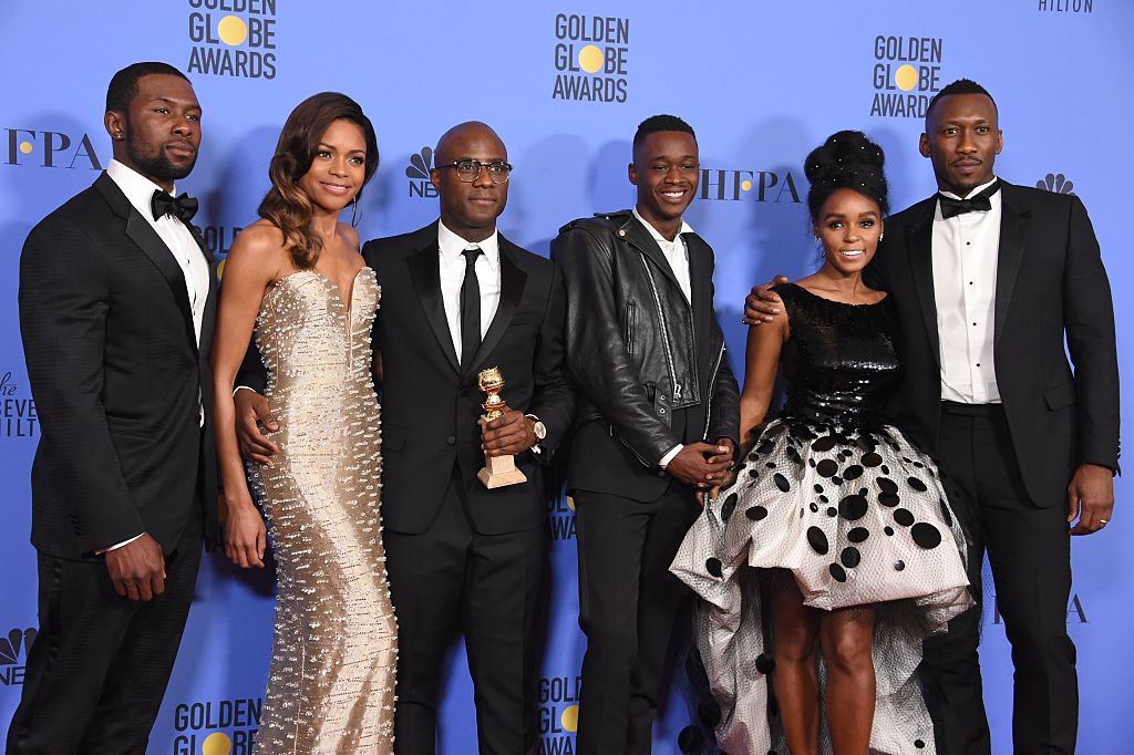 (L-R) Actors Trevante Rhodes and Naomie Harris, director Barry Jenkins, actors Ashton Sanders, Janelle Monae and Mahershala Ali of 'Moonlight,' winner of Best Motion Picture - Drama, pose in the press room during the 74th Annual Golden Globe Awards at The Beverly Hilton Hotel on January 8, 2017 in Beverly Hills, California. / AFP / ROBYN BECK (Photo credit should read ROBYN BECK/AFP/Getty Images)