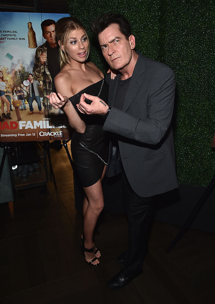 "Actors Charlotte McKinney and Charlie Sheen attend the premiere party for Crackle's ""Mad Families"" at Catch on January 9, 2017 in West Hollywood, California. (Photo by Alberto E. Rodriguez/Getty Images)"