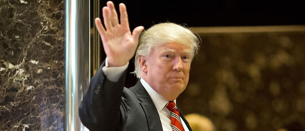 President-elect Donald Trump waves toward the media after meeting Martin Luther King III at Trump Tower in New York City on January 16, 2017. (Photo credit: DOMINICK REUTER/AFP/Getty Images)