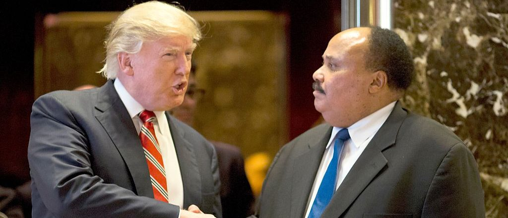 US President-elect Donald Trump shakes hands with Martin Luther King III after meeting at Trump Tower in New York City on January 16, 2017.  The eldest son of American civil rights icon Martin Luther King Jr. met with US President-elect Donald Trump on the national holiday observed in remembrance of his late father. / AFP / DOMINICK REUTER        (Photo credit should read DOMINICK REUTER/AFP/Getty Images)