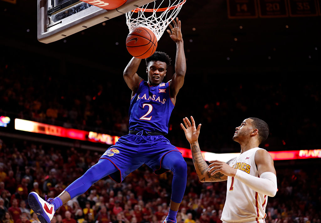 Lagerald Vick #2 of the Kansas Jayhawks dunks the ball as Nick Weiler-Babb #1 of the Iowa State Cyclones watches on in the second half of play at Hilton Coliseum on January 16, 2017 in Ames, Iowa. The Kansas Jayhawks won 76-72 over the Iowa State Cyclones. (Photo by David Purdy/Getty Images)