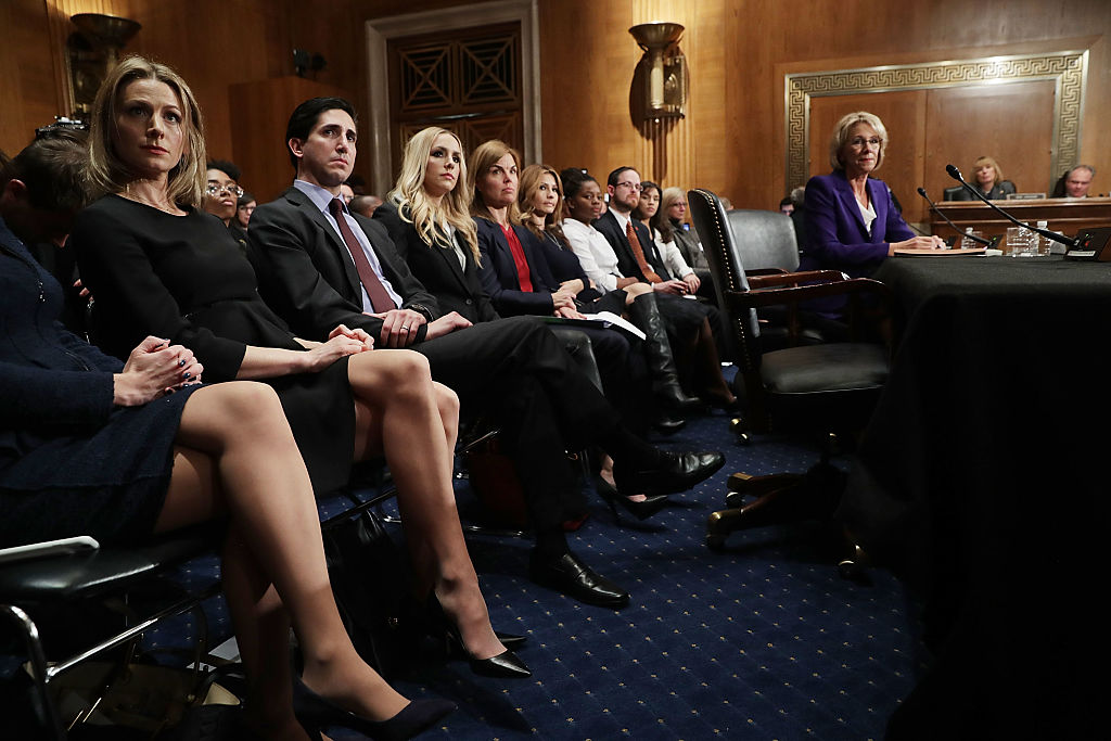Betsy Devos and her family attend a Senate Health & Education Committee confirmation hearing (Getty Images)