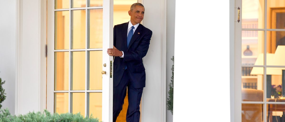 TOPSHOT - US President Barack Obama departs the Oval Office for the last time as president, at the White House in Washington, DC January 20, 2017. / AFP / JIM WATSON (Photo credit should read JIM WATSON/AFP/Getty Images)