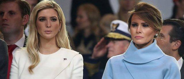 First lady Melania Trump stands with Ivanka Trump as a parade passes the inaugural parade reviewing stand in front of the White House on January 20, 2017 in Washington, D.C. (Photo by Mark Wilson/Getty Images)