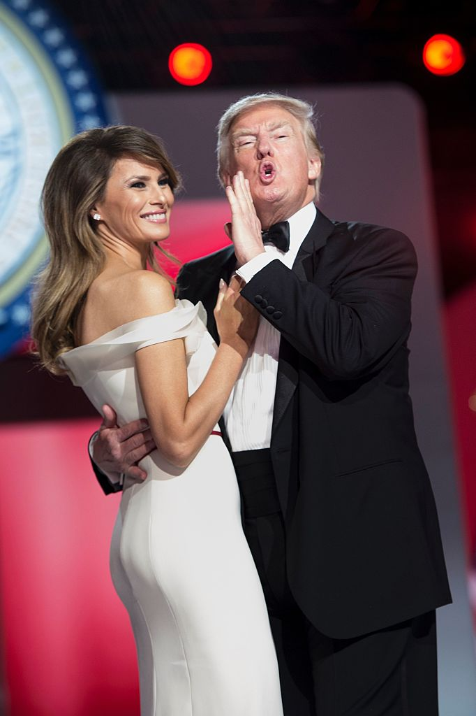 US President Donald Trump tells the crowd he loves them while dancing with US first lady Melania Trump during the Freedom Ball January 20, 2017 in Washington, DC. / AFP / Brendan Smialowski (Photo credit should read BRENDAN SMIALOWSKI/AFP/Getty Images)