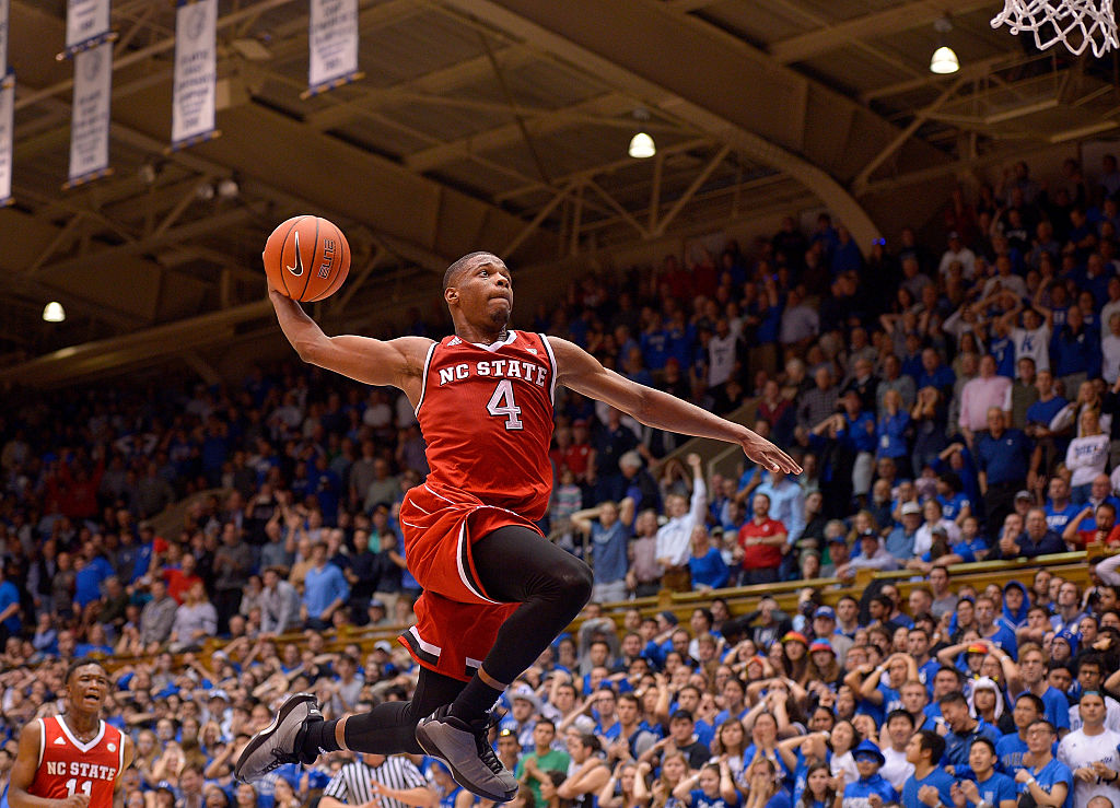 Dennis Smith Jr. #4 of the North Carolina State Wolfpack drives in for a dunk as time expires during their win against the Duke Blue Devils at Cameron Indoor Stadium on January 23, 2017 in Durham, North Carolina. North Carolina State won 84-82. (Photo by Grant Halverson/Getty Images)