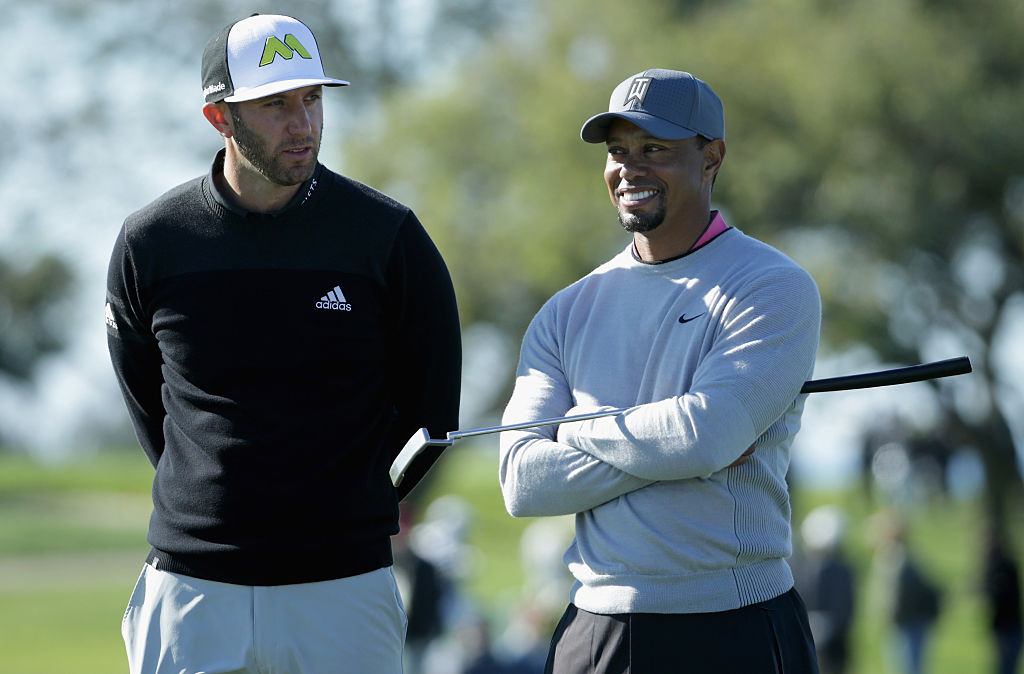 Dustin Johnson and Tiger Woods wait to putt on the 12th green during the second round of the Farmers Insurance Open at Torrey Pines North on January 27, 2017 in San Diego, California. (Photo by Jeff Gross/Getty Images)