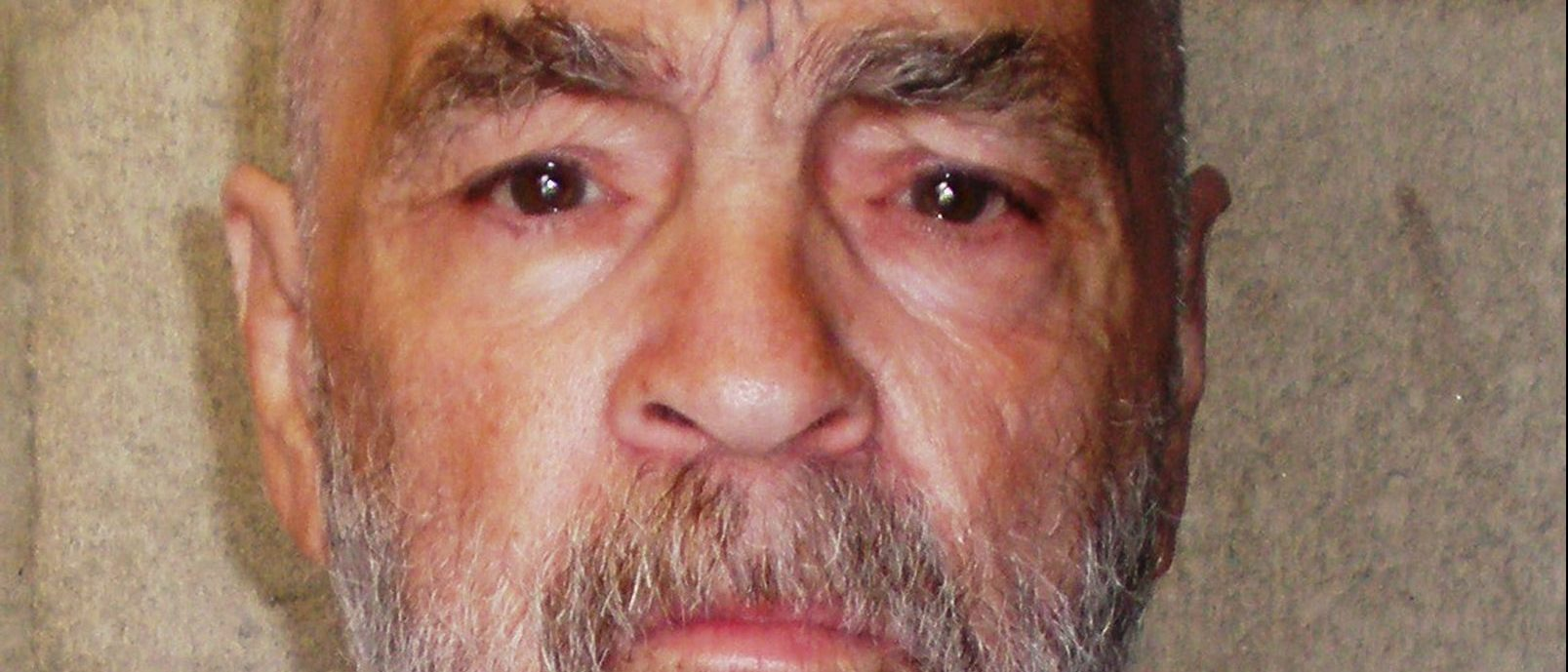 """CORCORAN STATE PRISON - MARCH 18: In this handout photo from the California Department of Corrections and Rehabilitation, Charles Manson, 74, is seen March 18, 2009 at Corcoran State Prison, California. Manson is serving a life sentence for conspiring to murder seven people during the """"Manson family"""" killings in 1969. The picture was taken as a regular update of the prison's files. (Photo by California Department of Corrections and Rehabilitation via Getty Images)"""