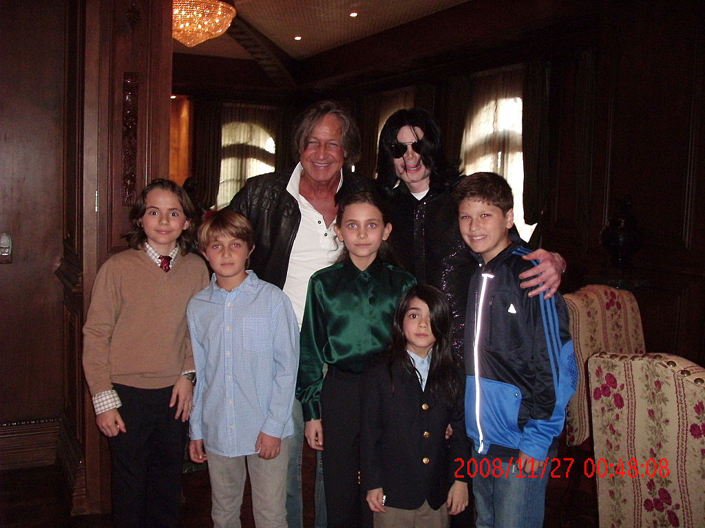 In this handout photo provided by Mohamed Hadid, singer Michael Jackson (3rd R) poses with real estate developer Mohamed Hadid (3rd L), Hadid's children and Jackson's children Michael Joseph Jr. (L), Paris Michael Katherine (C) and Prince Michael II (2nd R) on November 27, 2008 at the Jackson Holmby Hills residence in Westwood, California. Michael Jackson spent his final days in the house that Hadid had originally built and that Jackson leased for $100,000 a month from the current owner. Hadid, who calls himself a close friend of Michael Jackson, spent some of Jackson's last days with him and is now speaking out about Jackson's health and state of mind during the last few weeks before his death. (Photo by Mohamed Hadid via Getty Images)