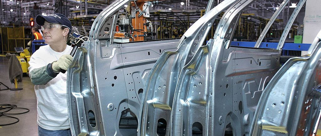 LANSING, MI - MARCH 10: General Motors employees assemble a GM crossover SUV on the assembly line at the GM Lansing Delta Township Assembly Plant March 10, 2010 in Lansing, Michigan. The Delta plant has more than 3,000 workers on two shifts and is expected to add a third shift of 900-1,000 workers in April. The plant produces the Buick Enclave, Chevrolet Traverse, and GMC Acadia crossover SUVs. (Photo by Bill Pugliano/Getty Images)