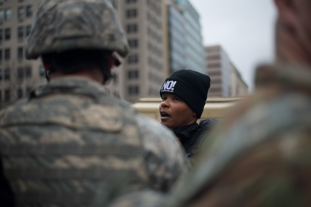 Protester speaks to a National Guard soldier on a security line - Daily Caller - Abbey Jaroma