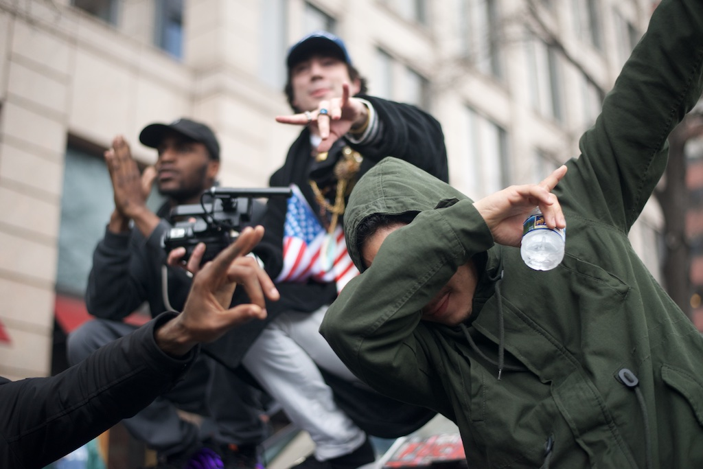 Protesters pose on top of a vandalised limosine - Daily Caller - Abbey Jaroma