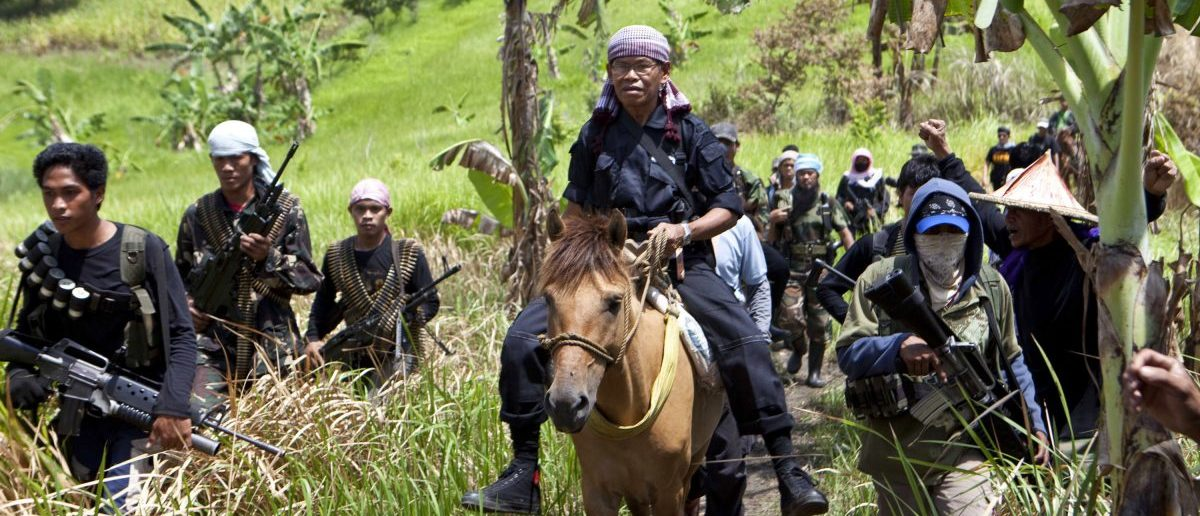 Moro Islamic Liberation Front (MILF) rogue commander Ustadz Ameril Umbra Kato rides a horse as he arrives with his followers before the start of a clandestine news conference in their camp in Maguindanao province, southern Philippines August 28, 2011. Kato broke away late last year to continue fighting for an independent Islamic state in the south of the mostly Roman Catholic country, but the MILF had maintained it was an internal matter and they could bring him back into the fold. Picture taken August 28, 2011.  REUTERS/Joe Penney