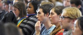 Penn State students listen to university officials during Penn State's first ever  town hall forum on campus in State College, Pennsylvania, November 30, 2011. Students asked questions of the top university officials in the wake of the recent sex scandal involving former football defensive coordinator Jerry Sandusky.     REUTERS/Pat Little   (UNITED STATES - Tags: SPORT FOOTBALL CRIME LAW EDUCATION) - RTR2UOGJ