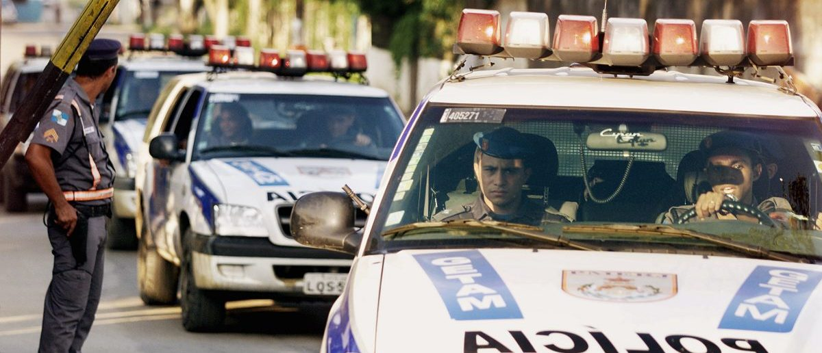 Police enter the Bangu 3 prison complex to stop a rebellion by inmates, in Rio de Janeiro, December 2, 2003. One prison guard was killed and two were wounded on Tuesday when a group of inmates in the prison rebelled, taking about 20 people hostage, Brazilian authorities said. The inmates were complaining of ill-treatment and were demanding better conditions, authorities said. The authorities said Bangu 3 was not overcrowded. Jail riots are common in Brazil, where prison conditions are notoriously bad and are described by human rights defenders as inhumane. REUTERSBruno Domingos