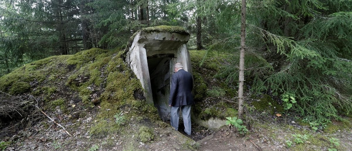 Former Soviet Army officer Leonid Konovalov enters underground bomb shelter at the abandoned former Soviet R12 nuclear missile base in Zeltini, Latvia, July 22, 2016. Picture taken July 22, 2016. REUTERS/Ints Kalnins