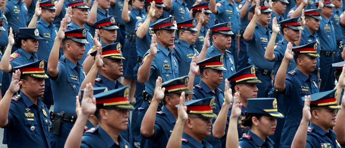 Police officers take their oath at the Philippine National Police (PNP) headquarters in Quezon city, Metro Manila, Philippines January 30, 2017. REUTERS/Czar Dancel