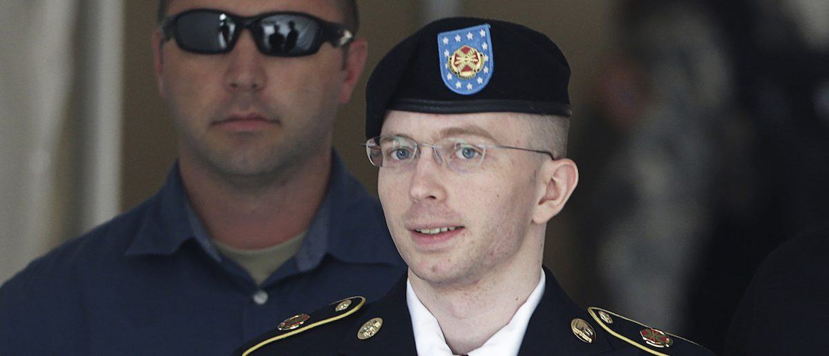U.S. Army Private First Class Bradley Manning (C) departs the courthouse at Fort Meade, Maryland July 30, 2013. A military judge on Tuesday found Manning not guilty of aiding the enemy - the most serious charge among many he faced for handing over documents to WikiLeaks. But Col. Denise Lind, in her verdict, found Manning, 25, guilty of 19 of the other 20 criminal counts in the biggest breach of classified information in the nation's history. REUTERS/Gary Cameron