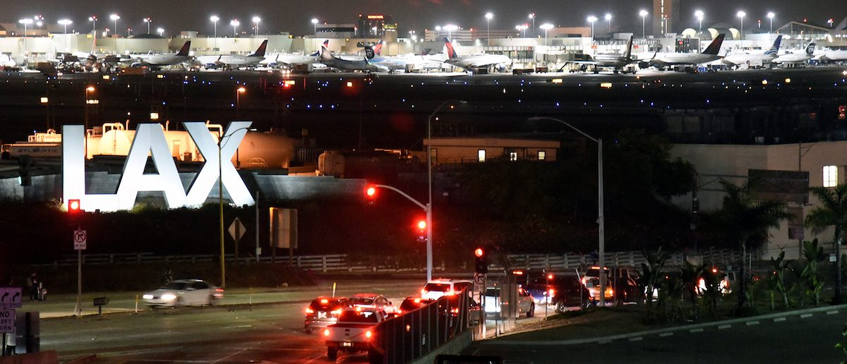 Traffic is seen near the LAX sign, as terminals at Los Angeles International Airport were evacuated briefly late on Sunday following a false alarm, in Los Angeles, California, U.S., August 28, 2016.  REUTERS/Bob Riha Jr  TPX IMAGES OF THE DAY - RTX2NEHU